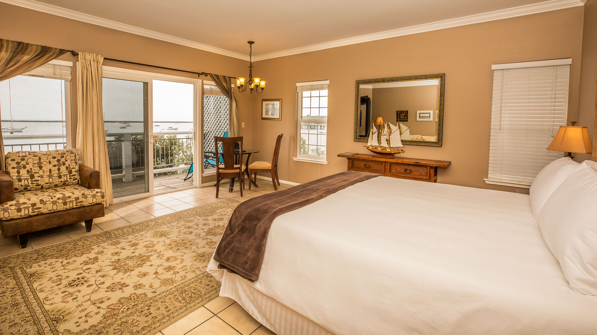 Montara Room With King Bed, Sofa Chair, And Dining Table